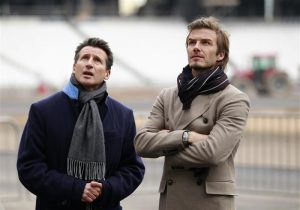 British soccer player David Beckham (R) and the Chair of the London 2012 Organising Committee, Sebastian Coe, pose for a photograph during a visit to the main Olympic stadium, in London November 29, 2010. REUTERS/Matt Dunham/Pool